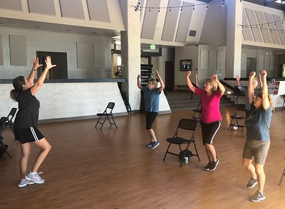 Annette Mathews teaches a class of senior students fitness exercises at the Lakeside Pavilion in Chico on Tuesday morning. (Natalie Hanson -- Enterprise-Record)