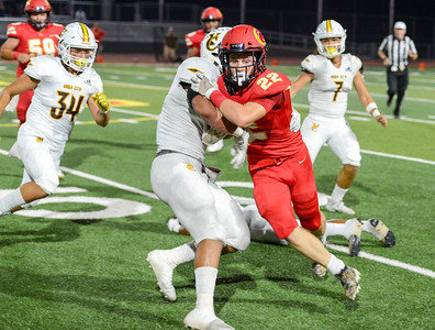Chico's Atticus Mikles tries to get past Yuba City's Luke Afato during the Panthers' home opener against the Honkers on Sept. 13 in Chico. (Matt Bates -- Enterprise-Record)