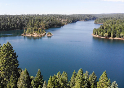 A proposal to reduce Chico's dependence on well water would involve moving water through Paradise Lake, thence through the Paradise Irrigation District's treatment plant and water lines, into a new pipe that would run down the Skyway to Chico. The lake is seen Thursday in Magalia. (Matt Bates -- Enterprise-Record)