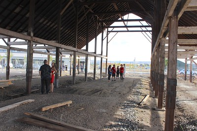 Family members and friends explore the old DeMeyer farm and barn Saturday morning at Meriam Park. The barn used to stand at Meridian Road and West Sacramento Avenue, but it was taken down in 2017 and is now being reassembled off Alcott Avenue. (Steve Schoonover -- Enterprise-Record)