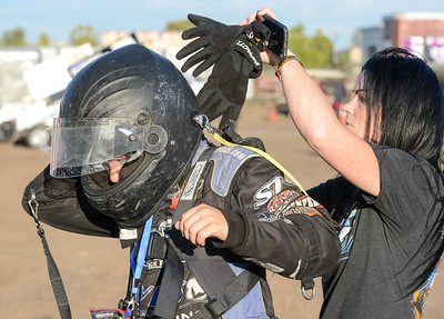 Alex Fowler, 15, gets help with his helmet from mom Leanne before the Gold Cup Race of Champions at the Silver Dollar Speedway on Thursday in Chico. (Matt Bates -- Enterprise-Record)