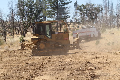 A bulldozer makes a barrier Friday in the brush to keep the Forbestown Fire near Oroville at bay. (Jake Hutchison -- Enterprise-Record)
