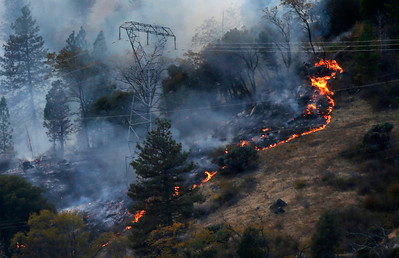 Fire burns near PG&E transmission towers, Nov. 12, east Pulga. The first report of the deadly Camp Fire was made near another tower on this line. (Karl Mondon -- Bay Area News Group file)