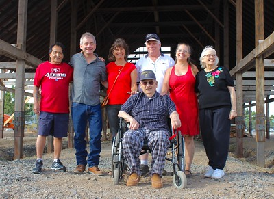 At a reunion Saturday with the old family barn being reassembled at Meriam Park are Andy Ramirez, Greg DeMeyer, Dianne Suschil, Chris DeMeyer, Sharon DeMeyer, Dayle Perry, with Ray DeMeyer in the foreground. (Steve Schoonover -- Enterprise-Record)