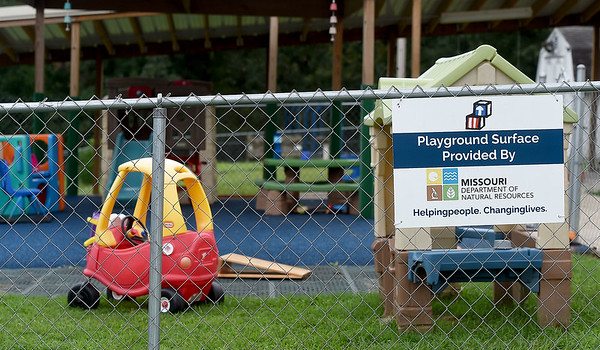 A small playground equipped with a pour in place compound courtesy of the Missouri Department of Natural Resources sits in the Sputh Joplin Head Start.. The surface is a lower maintenance solution for fall zones as compared to rubber mulch. Globe | Laurie Sisk