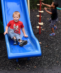 From the left: Walker Smith, 3 and Emmanuel Sang, 4, play on a slide at the South Joplin Head Start on Thursday. The loose rubber mulch surface is being replaced by a pour in place compound courtesy of a grant from the Economic Secuity Corp. and the Missouri Department of Natural Resources. The new surface is a lower maintenance solution for fall zones. Globe | Laurie Sisk