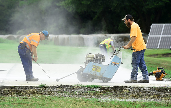 Workers continue progress on the construction of a new lighted basketball court on Wednesday at the Carl Junction Community Center. Globe | Laurie Sisk