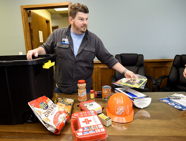 Show-Me Hope Team Leader John Blake displays suggested items for emergency kits at the Ozark Center Crisis Services on Monday. Globe | Laurie Sisk