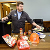 Show-Me Hope Team Leader John Blake displays suggested items for emergency kits at the Ozark Center Crisis Services on Monday.<br /> Globe | Laurie Sisk