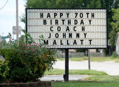 A sign at the Riverton Community Center and Fire Department wishes longtime Riverton Coach Johnny Mallatt a happy birthday. Globe | Laurie Sisk