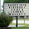A sign at the Riverton Community Center and Fire Department wishes longtime Riverton Coach Johnny Mallatt a happy birthday.<br /> Globe | Laurie Sisk