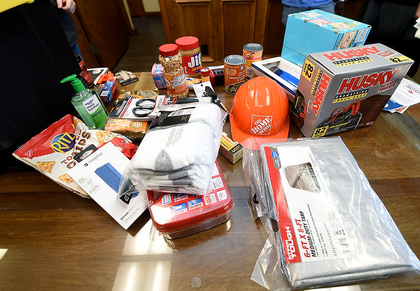 Suggested items for an emergency kit are displayed on a table at the Ozark Center Crisis Services on Monday. Globe | Laurie Sisk