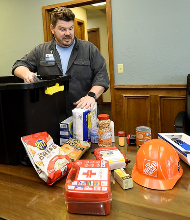Show-Me Hope Team Leader John Blake talks about some suggested items for emergency kits at the Ozark Center Crisis Services on Monday. Globe | Laurie Sisk