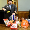 Show-Me Hope Team Leader John Blake talks about some suggested items for emergency kits at the Ozark Center Crisis Services on Monday.<br /> Globe | Laurie Sisk