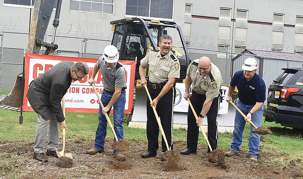 From the left: Architect Chris Birkenmaier,  Crossland Construction Project Manager Matt Baker, Jasper County Sheriff Randee Kaiser, Assistant Jail Administrator Lt. Alvin Peavler and Crossland Division Manager Danny Langerot turn ceremonial dirt during groundbreaking for the Jasper County Jail expansion project on Wednesday in Carthage. The project will add about 100 beds to the jail, with additional space for interview rooms, visitation spaces, video hearings, telemedicine and telecounseling appointments.  Globe | Laurie Sisk