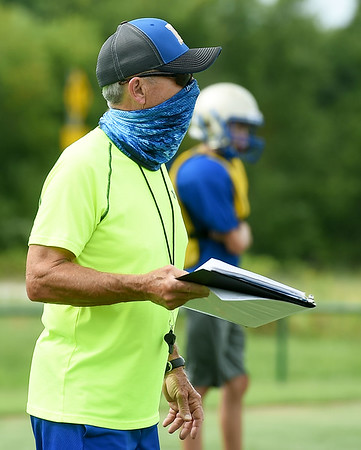 Longtime Riverton Coach Johnny Mallatt works with his players during practice last week at RHS.<br /> Globe   Laurie Sisk