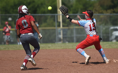 Webb City's Shea-lee Key (15) gets the force out on Nevada's Kara Phillips (0) during the championship game of the Joplin High School Tournament on Saturday at the Joplin Athletic Complex. Globe | Laurie Sisk