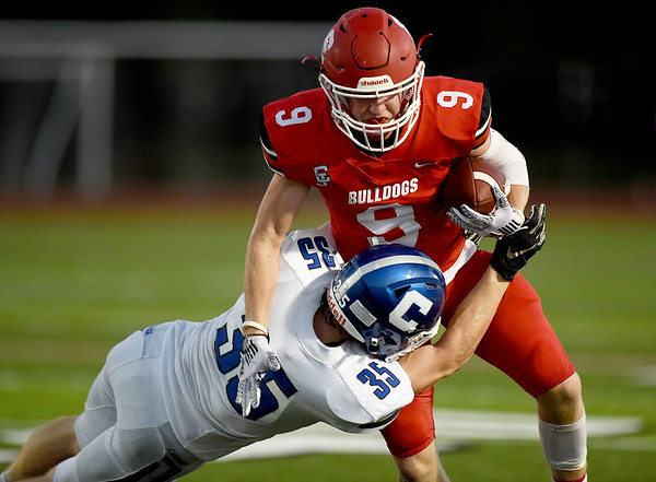 Carl Junction runningback Brady Sims (9) tries to get past Carthage defensive back Caleb Calvin (35) during their game on Friday night at CJHS.<br /> Globe | Laurie Sisk