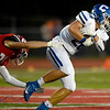 Carthage return man Sylas Browning (28) tries to break the grip of Carl Junction's Blake Poorman (23) during their game on Friday night at CJHS.<br /> Globe | Laurie Sisk