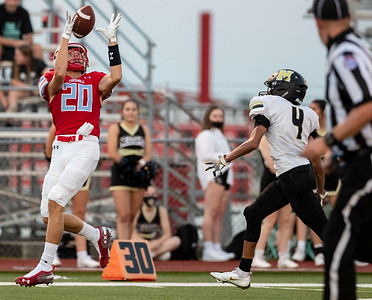 Webb City's Asa Morgan catches the ball at the 27 yard line against the pressure of Neosho's Brandt Gonzales during their game on Friday evening at Webb City High School. Globe|Israel Perez
