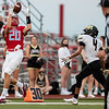 Webb City's Asa Morgan catches the ball at the 27 yard line against the pressure of Neosho's Brandt Gonzales during their game on Friday evening at Webb City High School.<br /> Globe|Israel Perez
