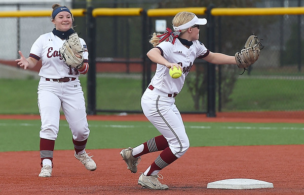Joplin's Isabella Yust, right, throws  runner out as teammate Reece Shroer looks on during the Eagles' game against McDonald County on Tuesday at JHS. Yust celebrated her Sweet 16 during JHS' home opener. Globe | Laurie Sisk
