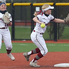 Joplin's Isabella Yust, right, throws  runner out as teammate Reece Shroer looks on during the Eagles' game against McDonald County on Tuesday at JHS. Yust celebrated her Sweet 16 during JHS' home opener.<br /> Globe | Laurie Sisk