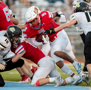 Webb City's Devrin Weathers with the ball pushes through the defensive line for 6 points against the Neosho Wildcats during their game on Friday evening at Webb City High School. Globe|Israel Perez