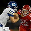 Carthage quarterback Patrick Carlton (17) tries to get past Carl Junction linebacker Carter Kennedy (22) during their game on Friday night at CJHS.<br /> Globe | Laurie Sisk