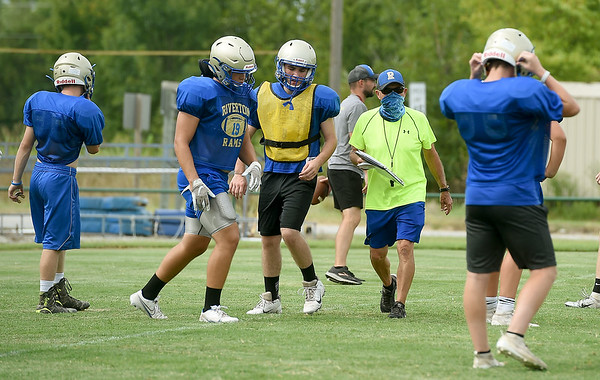 Longtime Riverton Coach Johnny Mallatt works with his players during practice last week at RHS.<br /> Globe | Laurie Sisk