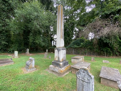 The obelisk marking the grave of D.H. Hill, and other smaller grave markers of members of the Hill family.