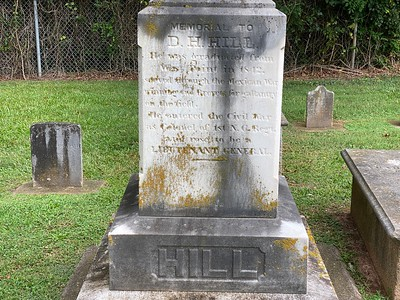 "The base of the memorial stone on D.H. Hill's grave. ""He was graduated from West Point in 1842, served through the Mexican War, winning two brevets for gallantry on the field. He entered the Civil War as Colonel of 1st N.C. Regiment. and rose to be a Lieutenant General."""