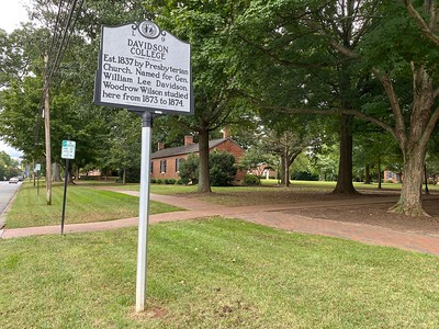 One of three N.C. Historic Highway Markers in the town of Davidson. The program began in 1935 and each sign is hand-made, cast of aluminum. This sign is located on the campus side of Main Street.