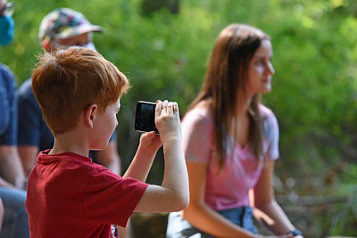 One of the younger guests was documenting the special event.