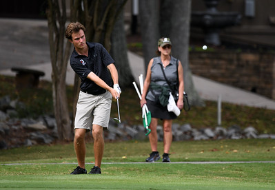 Wildcat golfer Alex Heffner chips from just off the green at the 9th during the first round of the River Run Collegiate.