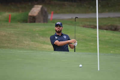 This Howard Bison golfer can pleased with his effort from the greenside bunker at the 9th.