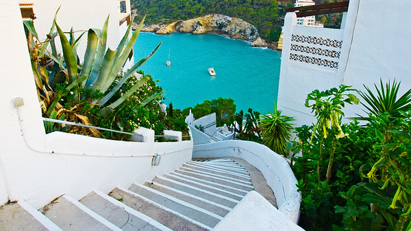 Winding steps down to azure waters