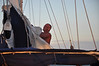 First mate, Mike, is always fiddling with something (not the books, the sails)