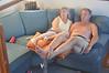 Skipper & partner relax, before falling asleep, watching a DVD