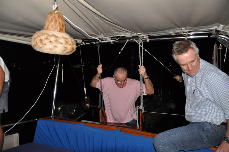Wirh Ashley onboard,Mike demonstrates how easy getting up Serengeti's stern ladder is when you've had six very large G&Ts and a bottle of Rose