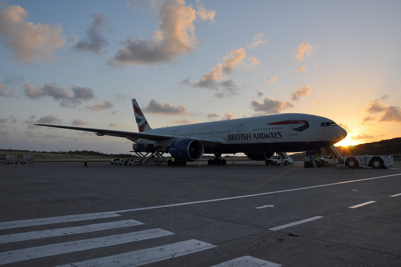 The sun is setting on the BA aircraft on the tarmac at Grenada International Airport
