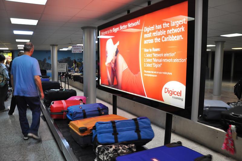 Sheila & Ian's luggage arrives on the baggage carousel