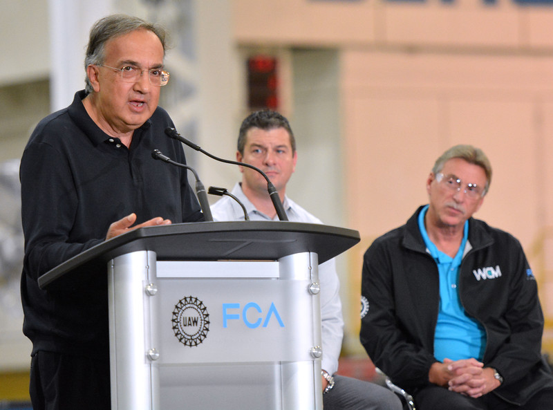 FCA's CEO Sergio Marchionne visited the Sterling Chrysler Stamping Plant. Listening to him talk to the employees of the plant is Plant Manager Lance Schwatz and UAW Vice President of FCA US Department, Norwood Jewell.  Ray Skowronek--The Macomb Daily