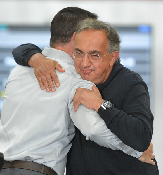 FCA's CEO Sergio Marchionne gives a big hug to Plant Manager Lance Schwartz after speaking to the employees of the Chrysler Sterling Plant .  Ray Skowronek--The Macomb Daily
