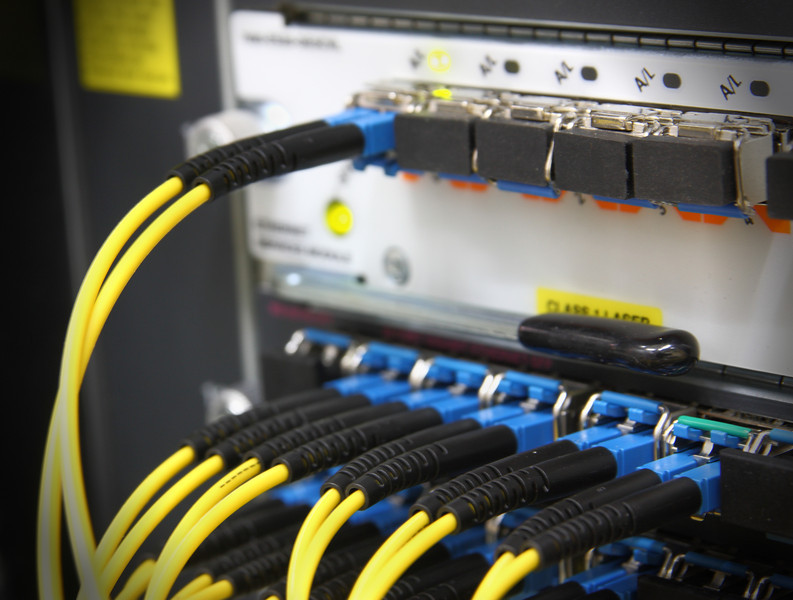 Fiber Optics with SC/LC connectors. Internet Service Provider equipment. Focus on fiber optic cables. Data Network Hardware Concept.