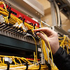 The technician attaching fiber optic on the telecom site