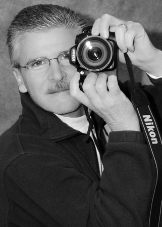 "<h2 class=""notopmargin"">Bio</h2>  <p>My passion for photography began 40 years ago when my father presented me with a Canon camera, a used 50mm lens, and a book on photography. They were the best gifts I ever received and I have been perfecting my skills ever since. Photography changed the way I viewed the world around me - a simple shadow or reflection became an opportunity to capture light from a different perspective and colors and textures became tools to create moods or suggest emotions.  Viewing life through the lens of a camera allowed me to slow down the world a little bit and become part of it. Every scene became a potential image to capture.  Photography became a wonderful addiction.  I feel at peace each time I venture out to capture an image.</p>  <p>I have attended photography seminars and workshops to learn the basics of the craft, and constructed B&W darkrooms in our homes, where I spent countless hours learning the secrets of light.  Now my darkroom is digital and I use state of the art software to process images in a timely and professional manner.  Even with all of the advances in color photography, the timeliness of black and white imagery remains as a personal favorite of mine.</p>  <p>Taking a person's photograph is very personal to me.  I strive to make every customer feel comfortable and work with them to achieve their ideal image - images that tell the story of their life, their day, or just a split second in time. I never tire of reviewing images after a session and seeing how my concepts and ideas materialized into inspirational images. Seeing the expression on a client's face when they view their images for the first time is what makes photography a passion, not a job.</p>"