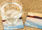 Photo Coasters  Durable, hard and glossy surface with cork back.  Coasters come in sets of 4 (only two are shown in this photo) and measure 3.75 x 3.75 inches. They're slightly more than 1/8th inch thick.  Coasters have good color reproduction, but not as accurate as photographic prints.  $29.95