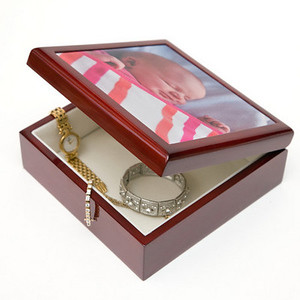 "Photo Keepsake Box Beautiful keepsake box made of solid wood, polished to a gorgeous shine. It has a cherry finish and a soft and velvety cream-colored interior.  Your 4.25"" by 4.25"" square image (or cropped portion of an image) is printed on ceramic tile and inlaid on top of the box.  Box dimensions: 5.5"" x 5.5"" x 2.25"" high.   Color reproduction on the keepsake box is nearly as accurate as on photographic prints.    $53.95"