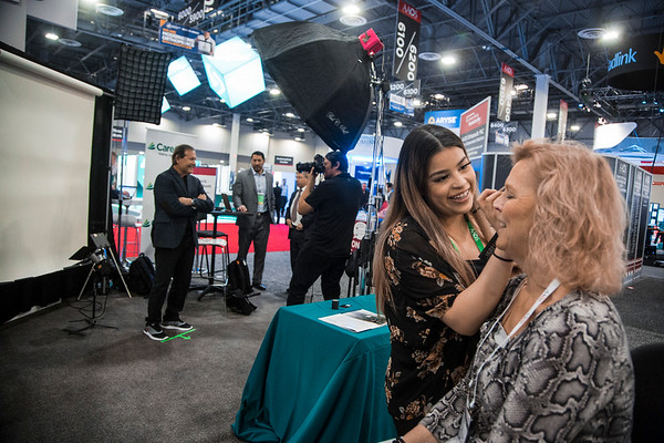Photographer and Attendees during AAOS Photo Booth
